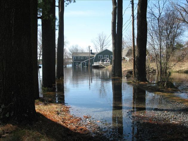 The Hutchens' home in Freetown is surrounded by the high waters of Long Pond. (Fred Thys/WBUR)