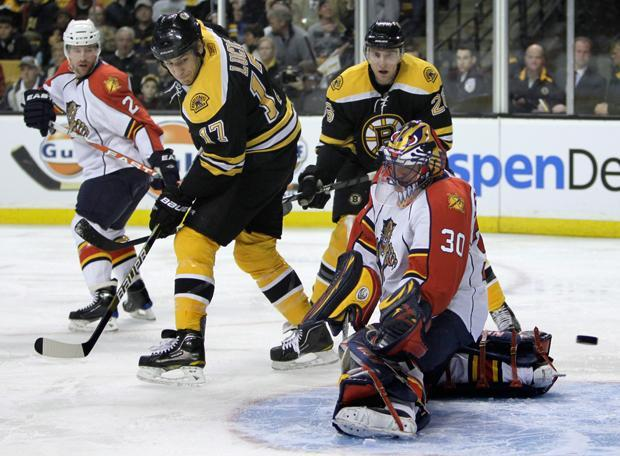 Florida goalie Scott Clemmensen makes a save on a shot tipped by Bruins left wing Milan Lucic (17) during a game on Thursday. (Charles Krupa/AP)
