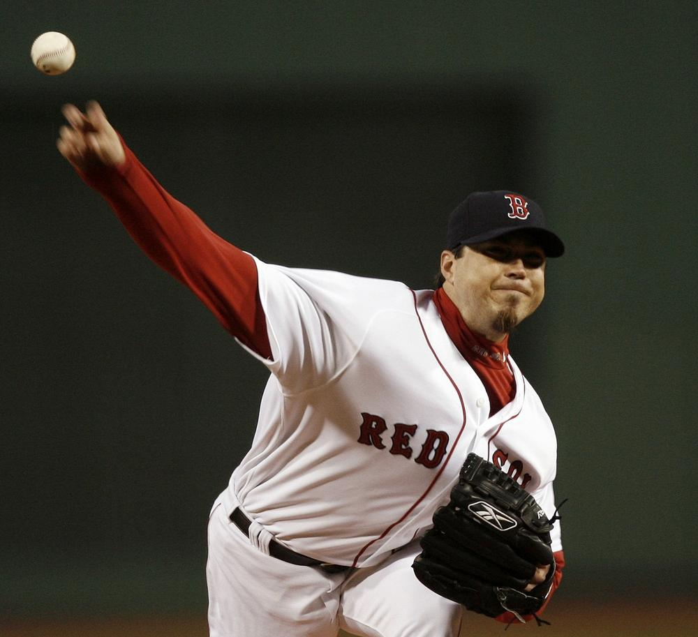 Josh Becket delivers a pitch against the New York Yankees at Fenway Park in 2007. (AP Photo/Winslow Townson)