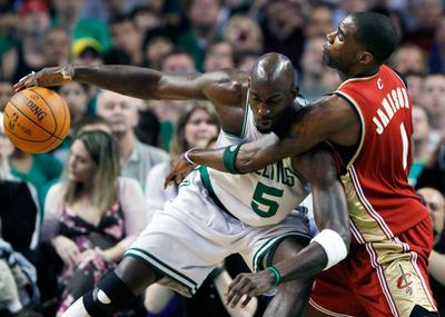 Boston Celtics' Kevin Garnett keeps the ball away from Cleveland Cavaliers' Antawn Jamison in the first quarter of an NBA basketball game on Sunday in Boston. (AP)