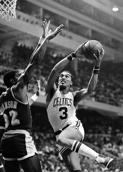 Here, Dennis Johnson, right, drives around Magic Johnson of the Los Angeles Lakers in the first game of the NBA Finals at the Boston Garden on May 28, 1984. Johnson was elected to the Basketball Hall of Fame Monday. (AP)