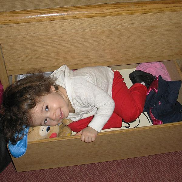 While living in a Boston hotel room, Annyeliz Sanchez, 2, created a bed for her stuffed animals — in a drawer.  (Monica Brady-Myerov/WBUR)