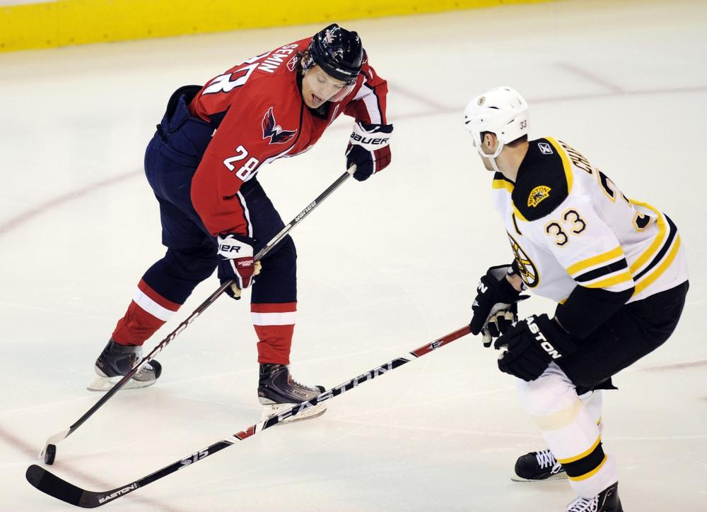 Capitals left wing Alexander Semin, of Russia, battles for the puck against Bruins defenseman Zdeno Chara, of Slovakia, during the second period of the game on Monday  in Washington. (Nick Wass/AP)
