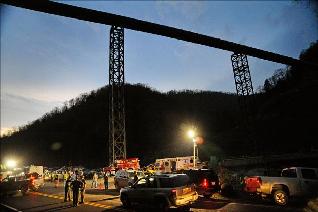 West Virginia State Police direct traffic at the entrance to Massey Energy's Upper Big Branch Coal Mine on Monday.  (Jeff Gentner/AP)