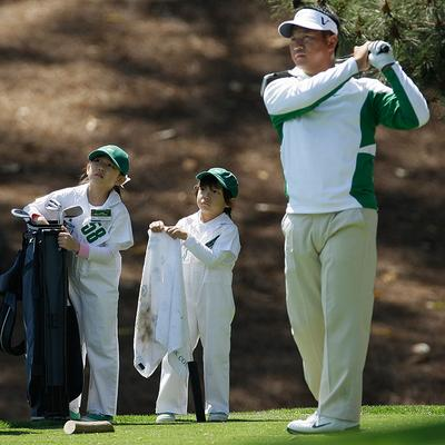 K.J. Choi's son, Daniel, and daughter, Amanda, watch their father's tee shot during the Par 3 contest before the Masters golf tournament in Augusta, Ga., on Wednesday. (AP)