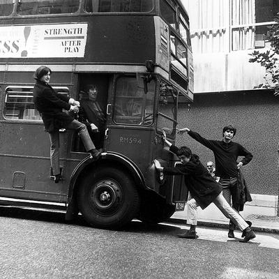 The Kinks joke around with a double-decker bus on a London street on Sept. 7, 1964. (AP) (Click to enlarge)