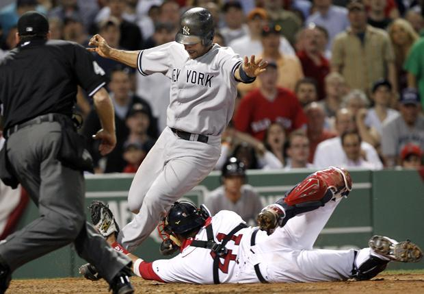 Boston catcher Victor Martinez stretches but cannot tag out Yankees' Jorge Posada in the seventh inning in a game at Fenway Park in Boston on Wednesday. (AP)