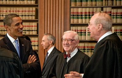 In this Sept. 8, 2009 file photo image released by the Supreme Court of the United States, President Obama, left, talks with Justices John Paul Stevens, center, and Anthony Kennedy, right. (AP)