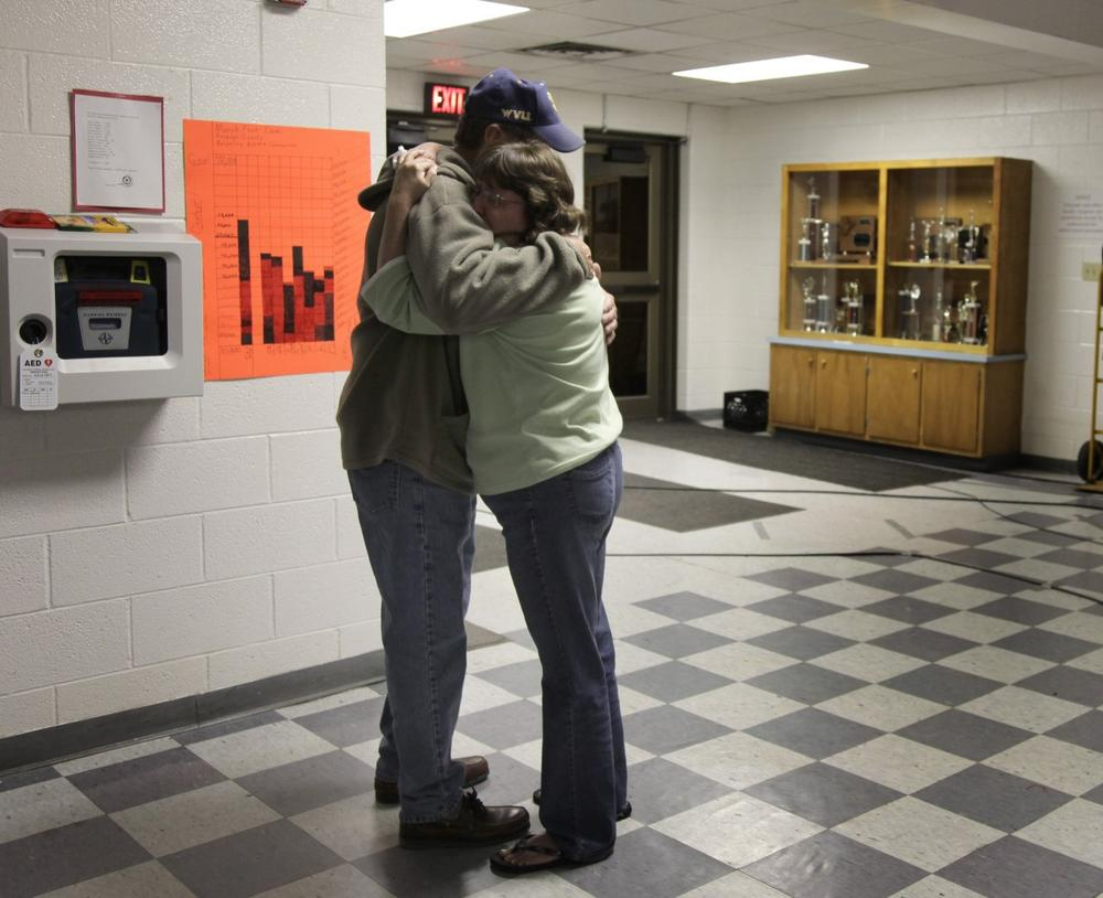 Tammy Gobble is embraced by her father Charles Dickens after hearing the news that rescue workers located the bodies of four missing miners deep in a West Virginia coal mine early Saturday morning in Montcoal W.Va. .  (AP Photo/Amy Sancetta)
