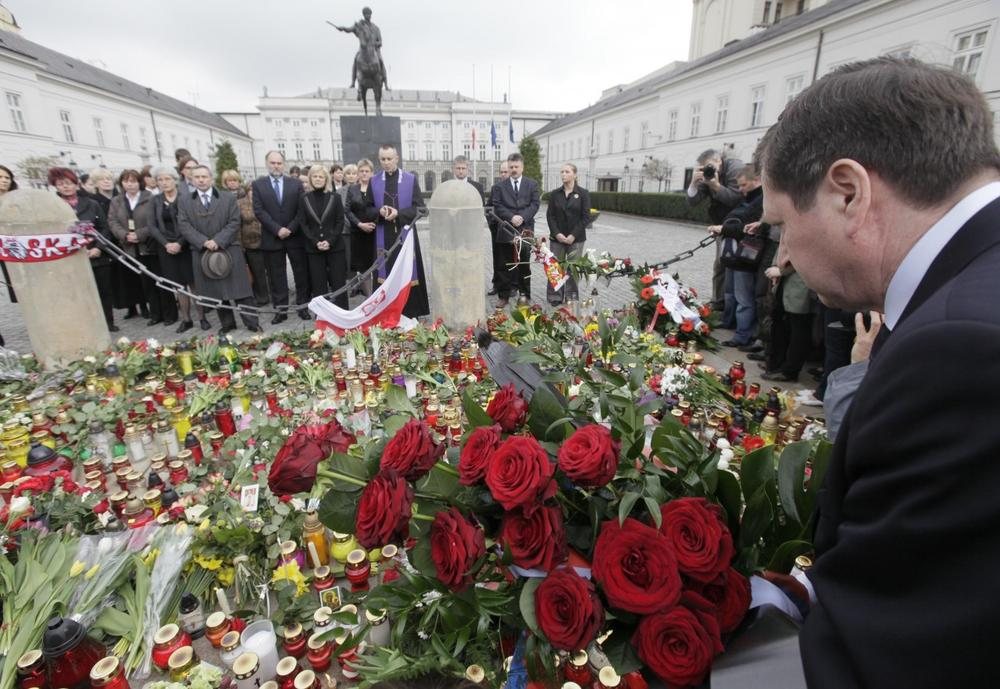 Staff of the Presidential Palace, background, hold a prayer in Warsaw, Poland, Saturday as news broke out about Polish President's Lech Kaczynski death. (AP Photo/Czarek Sokolowski)