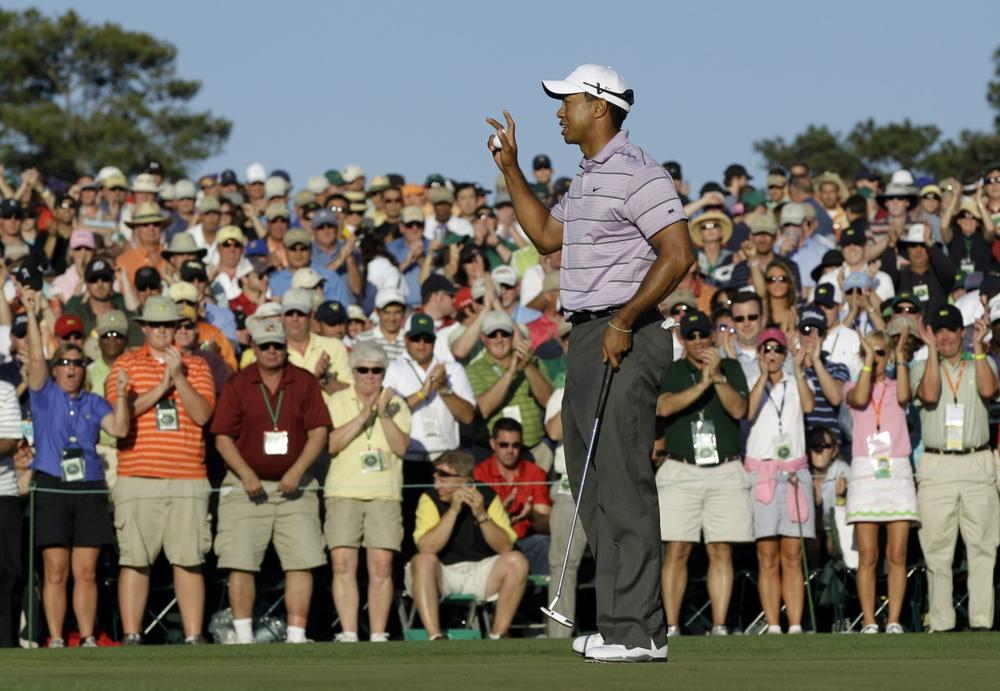 Tiger Woods waves to spectators on the 18th green after his third round of the Masters golf tournament in Augusta, Ga., Saturday. (AP Photo/David J. Phillip)