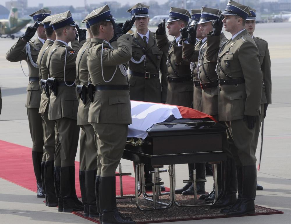 Polish Army soldiers salute in front of the coffin carrying the late Polish President Lech Kaczynski after arrival at the military airport in Warsaw, Poland, Sunday. (AP Photo/Alik Keplicz)