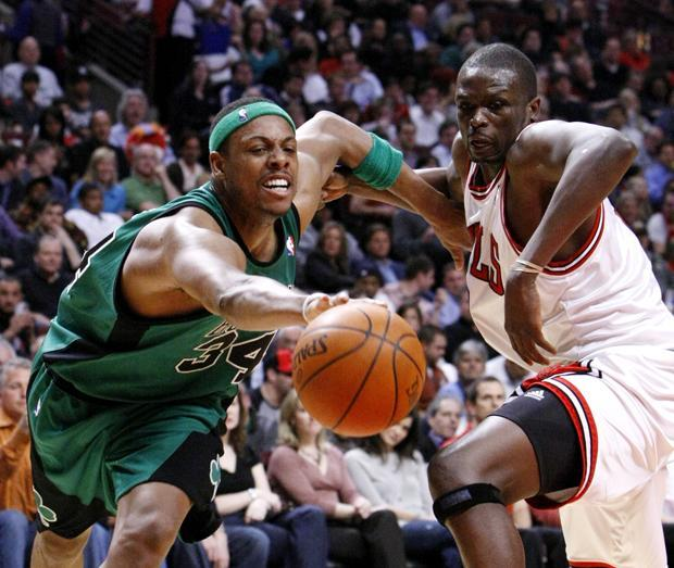 Boston forward Paul Pierce tries to retain control of the ball as Chicago forward Luol Deng pursues during the third quarter of the game on Tuesday in Chicago. (AP)