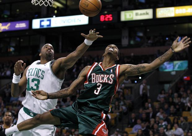 Boston forward Shelden Williams knocks the ball loose from Milwaukee guard Brandon Jennings as he drives during the first quarter of the game in Boston on Wednesday. (AP)