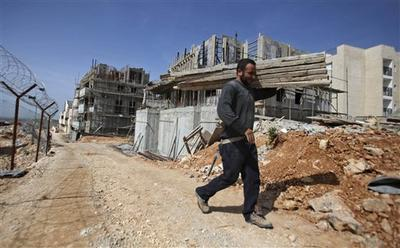 A Palestinian worker constructing homes in Beitar Illit, near Jerusalem. (AP)