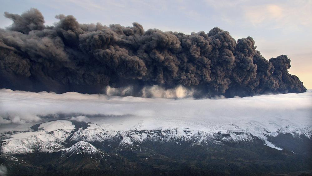 Smoke and steam hung over the volcano under the Eyjafjallajokull glacier in Iceland, which erupted for the second time in less than a month on Wednesday and disrupted worldwide traffic. (AP)