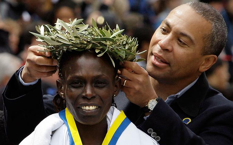 Women's winner Salina Kosgei, of Kenya, is crowned with the laurel wreath by Gov. Deval Patrick at the finish area at the 113th running of the Boston Marathon on April 20, 2009. (AP)
