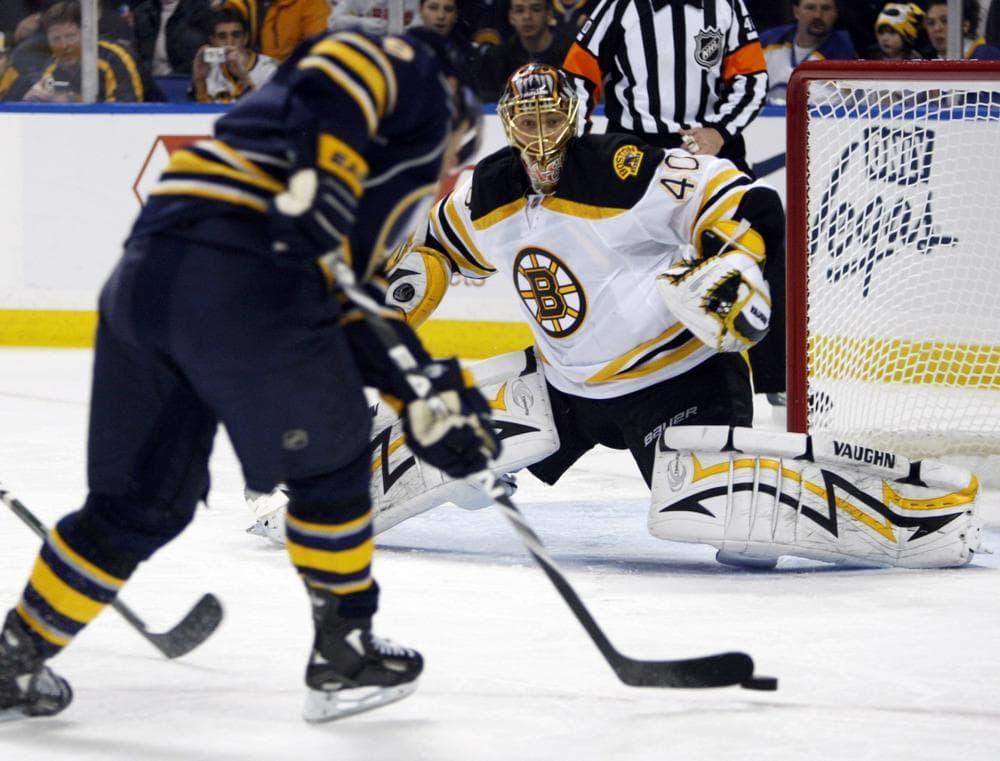 Bruins goalie Tuukka Rask, right, makes a save on a shot by Buffalo Sabres' Derek Roy. (AP Photo/ David Duprey)