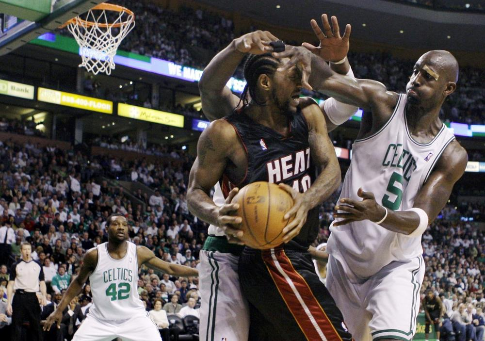 Celtics forwards Kevin Garnett, right, traps Miami Heat forward Udonis Haslem.(AP Photo/Charles Krupa)