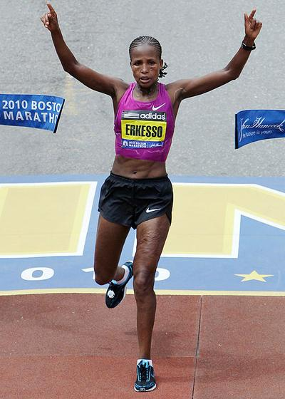 Teyba Erkesso, of Ethiopia, raises her arms as she breaks the finish line tape to win the Boston Marathon women's race on Monday. (AP) (Click to enlarge)
