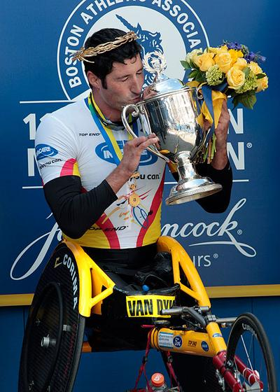 Men's wheelchair winner Ernst Van Dyk, of South Africa, kisses his trophy after the 114th running of the Boston Marathon on Monday. (AP) (Click to enlarge)
