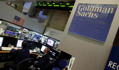 Traders work in the Goldman Sachs booth on the floor of the New York Stock Exchange. (AP)