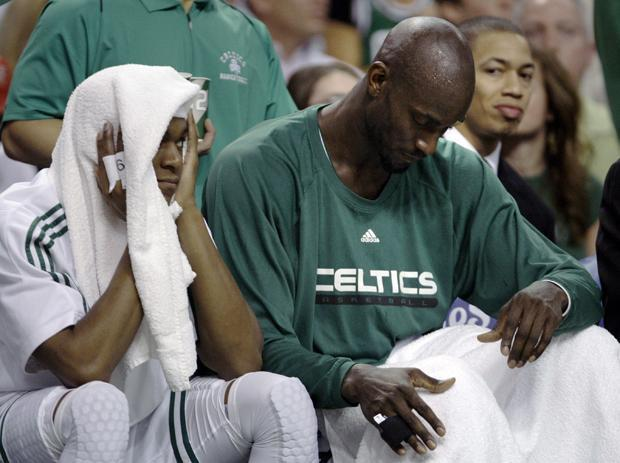 Boston forward Kevin Garnett and guard Rajon Rondo sit on the bench during the second quarter while trailing the Miami Heat during the first round of their playoff game in Boston on Saturday. (AP)