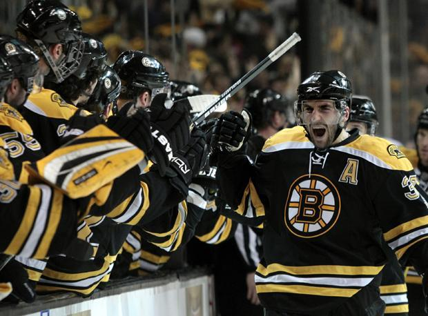 Boston center Patrice Bergeron celebrates his goal as he skates back to the bench during the third period of Game 3 against Buffalo in the playoff series in Boston on Monday. (AP)