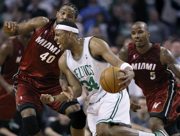 Boston forward Paul Pierce drives on Miami forward Udonis Haslem and guard Quentin Richardson during the second quarter of Game 2 in a first-round of the playoff series in Boston on Tuesday. (AP)