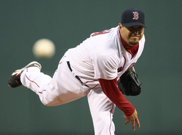 Boston starting pitcher Josh Beckett delivers during the first inning of the game against Texas at Fenway Park in Boston on Wednesday. (AP)