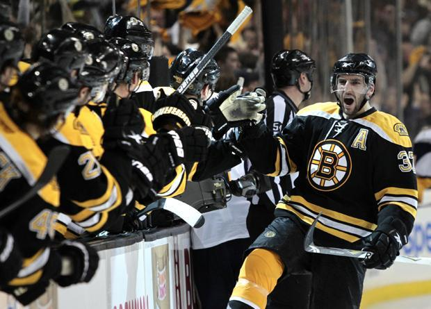 Boston center Patrice Bergeron celebrates his goal against Buffalo as he skates back to the bench during the third period of Game 4 of the first-round playoff series in Boston on Wednesday. (AP)