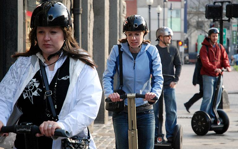 Riders take a recent Segway tour past Boston's Faneuil Hall. (Sonari Glinton for WBUR)