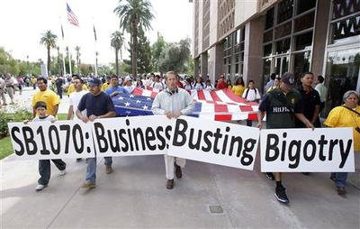 Hundreds of protesters rally at the Arizona Capitol to protest the possible signing of immigration bill SB1070 by Gov. Jan Brewer Friday, April 23, 2010, in Phoenix. (AP)