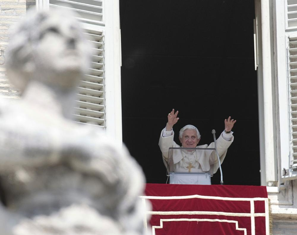Pope Benedict XVI greets the faithful during the Regina Caeli prayer in St. Peter's square, at the Vatican, Sunday. (AP Photo/Gregorio Borgia)
