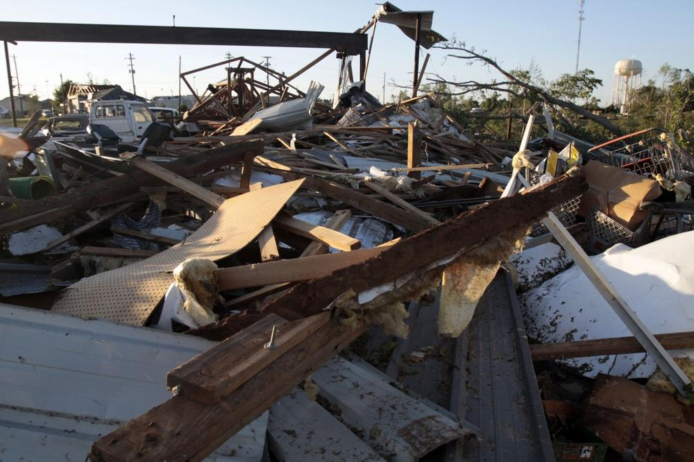 Nothing but debris is left of this Yazoo City, Miss., building Saturday, following a touchdown of a tornado which also damaged several businesses and homes and caused a number of deaths and injuries. (AP Photo/Rogelio V. Solis)