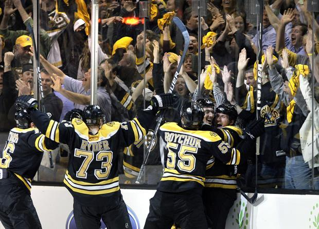 Boston celebrates winning Game 4 of the playoff series on Wednesday. The Bruins won 3-2. (AP Photo)