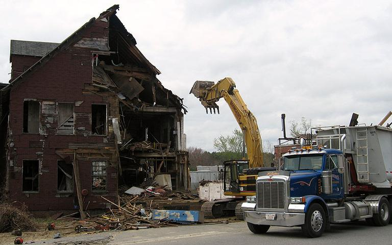A wrecking crew demolishes the S. Bent & Brothers, Inc., chair-making complex in Gardner. (David Boeri/WBUR)