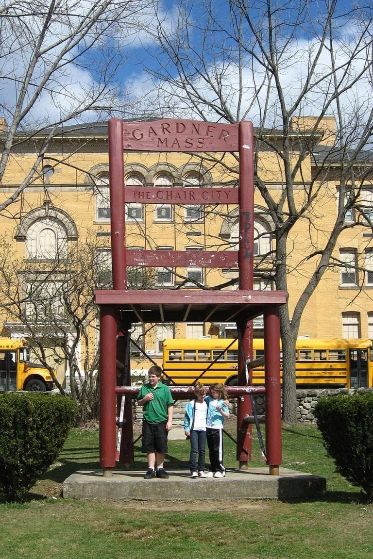 Children gather round 'Chair City's landmark. (David Boeri/WBUR)