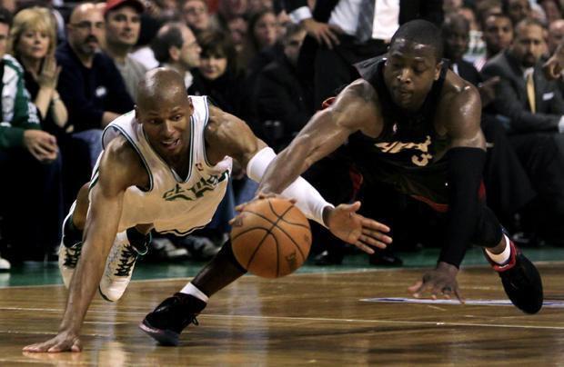 Boston guard Ray Allen and Miami guard Dwyane Wade dive for a loose ball during the first half of a first-round playoff game in Boston on Tuesday. (AP)