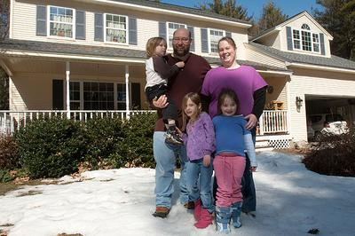 "Featured in our recent ""Depreciating American Dream"" series, the Quenneville family, of Merrimack, N.H., received the housing tax credit when they purchased a home last year.  Many question the overall effectiveness of the rebate program, however. (Jess Bidgood for WBUR)"