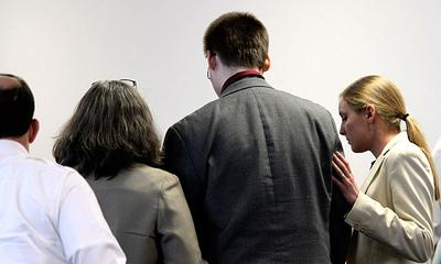 John Odgren, third from left, listens to the jury's verdict in his murder trial at Middlesex Superior Court in Woburn on Thursday. (AP/Pool)
