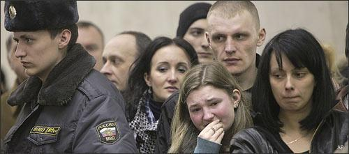 People stand at the site of a bombing in a Moscow subway station on March 31, 2010. (AP).