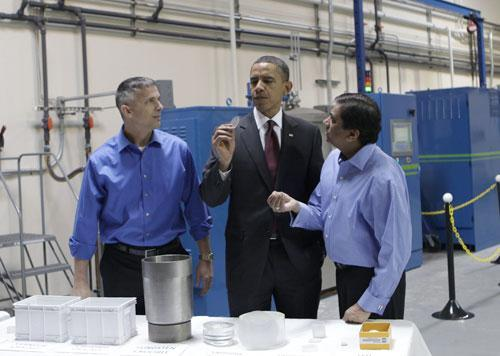 President Obama, with Dr. Kedar Gupta, right, and Dr. Carl Rick Schwedtfeger, left, from Arc Energy during his tour of an L.E.D. lighting manufacturer in Nashua, N.H., Tuesday, Feb. 2, 2010. (AP)