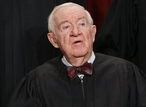 In this Sept. 29, 2009, file photo Associate Justice John Paul Stevens sits for a new group photograph at the Supreme Court in Washington. Stevens, leader of Supreme Court's liberals, will retire this summer. (AP)