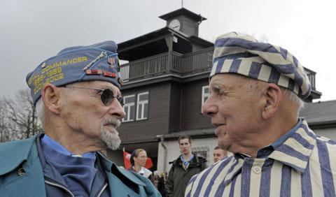 Nazi concentration camp survivor Viktor Savytskyi of Ukraine, right, talks with U.S. army veteran Clarence H. Brockman of Pennsylvania, left, in front of the Buchenwald camp entrance, April 11, 2010, during anniversary ceremonies.