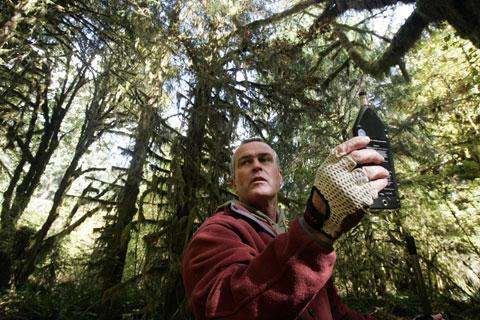 Acoustic ecologist Gordon Hempton uses a sound level meter in the Hoh Rain Forest of Olympic National Park, Wash., Oct. 2, 2006. (AP)