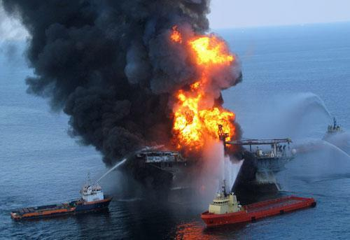 Fire boat response crews battle the remnants of the offshore oil rig Deepwater Horizon, 50 miles off the coast of Louisiana last Wednesday (AP/US Coast Guard)
