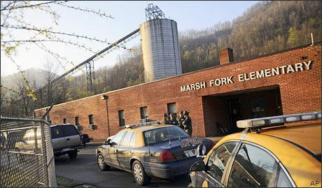 A Massey Energy coal silo towers over Marsh Fork Elementary Tuesday, April 6, 2010 near the Upper Big Branch Coal Mine in Naoma, W.Va. (AP)
