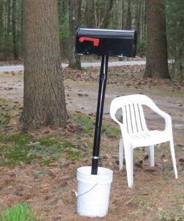Peg Lorenz wanted to plant her new mailbox the day she closed on her new home. It's had to wait. (Curt Nickisch/WBUR)