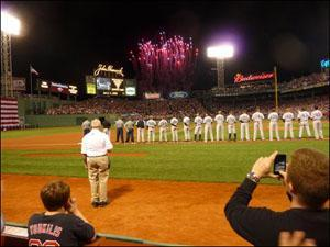 The players line up during the national anthem. (Sam Fleming/WBUR)